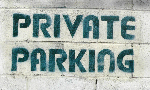 private parking spray painted to a wall
